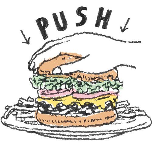 ハンバーガーは手でPUSHして食べる