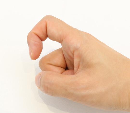 人差し指の第二関節を折り曲げ