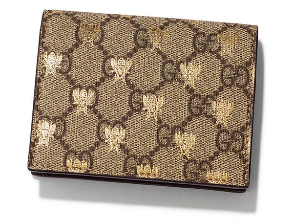 ゴールドのハチ柄がキュート。GUCCIの二つ折りミニ財布